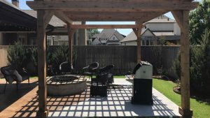 Photo of an outdoor living space with a firepit on the patio.